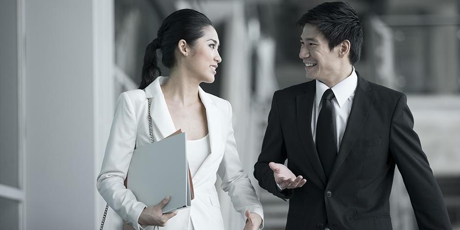 Asian business people talking outside