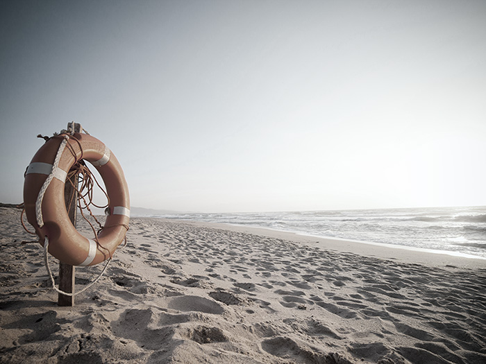 Life buoy in sunset