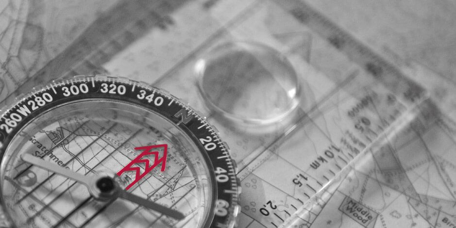 Compass laid over a map   Atradius